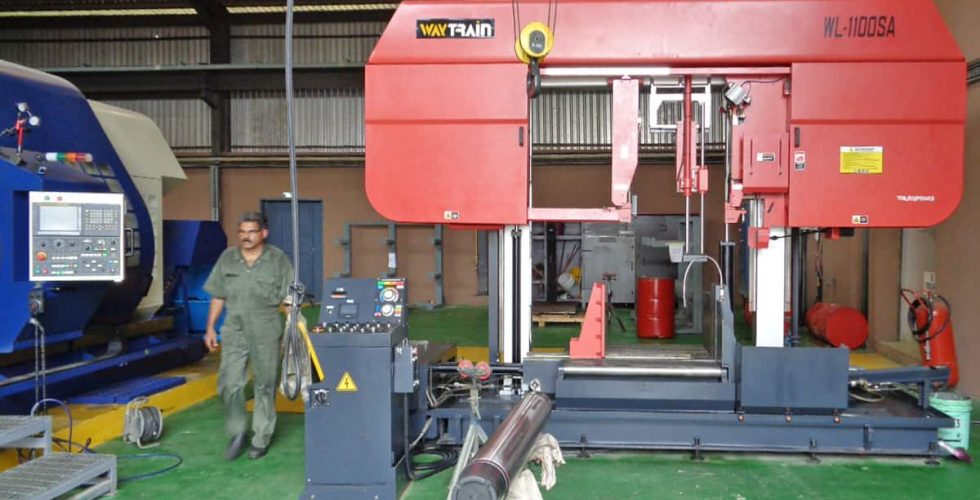 A new Megabore lathe and Way Train bandsaw being installed in Nigeria